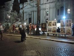 This is a photo taken in the square where artists were selling there paintings. So much life going on that we wouldn't have discovered without going on this night time tour of Rome. Cant wait to go ... , derrick t - September 2013