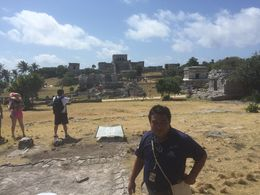 Carlos explains to us how the Mayas used the sun-watching platform to mark the passage of the sun with keyholes in the temples for summer and winter solstice , Brenda H - May 2016