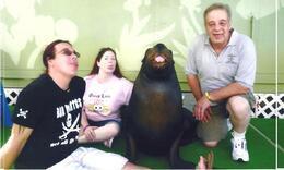 Enjoying our encounter with Oscar the sea lion at Coral World (from left Bratt, April and Jerry) , Brent B - November 2011