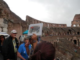 Photo of Rome Skip the Line: Ancient Rome and Colosseum Half-Day Walking Tour Our guide showing a drawing comparing the colosseum from then and now