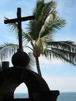Artsy shot of a palm tree and a cross. - April 2008