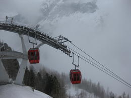 The gondola/cable cars that take you to and from the path to walk to the Mer de Glace entrance. , mdm - April 2013