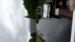 Canal mouth leading to Loch Ness, with a docked cruise boat. , Juha L - June 2015