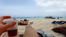 With a rum and coke from our group's open beach bar. , Allan - September 2015