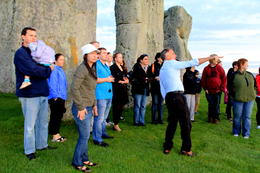 all of us while our tour guide pointing to the heelstone...the only stone outside the henge... , CECILE - September 2011