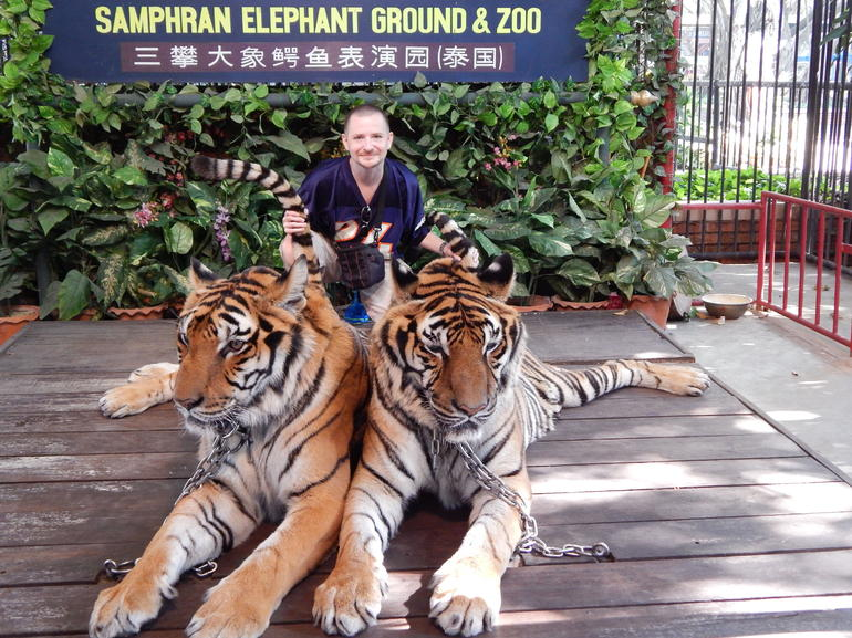 Kevin Teter with tigers on the tour.
