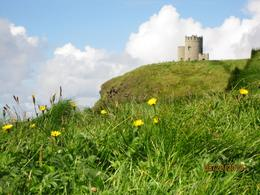 Photo of Dublin Limerick, Cliffs of Moher, Burren and Galway Bay Rail Tour from Dublin A small Castle at Cliffs of Moher