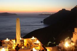 As the sun goes down the lights in the restaurants along the top of the caldera come up., Peter - October 2010