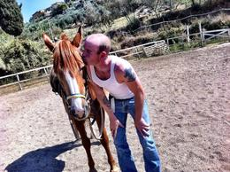 Dillon had a hard time parting with the horse :) , Therese H - September 2011