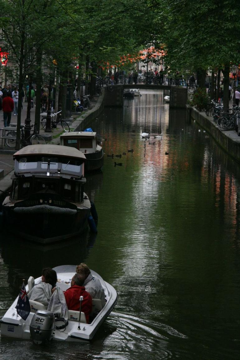 Red Lights shimmering in the canals - Amsterdam