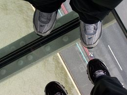 Me and my hubby standing on the glass platform inside the Tower Bridge , Scott T - October 2015