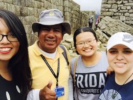Our tour guide and my friends enjoying machu picchu : , Cami - April 2016
