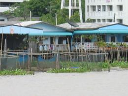 A picture of a house on the river. Picture taken while on the river cruise on the way to Bangkok., Diane B - July 2008