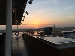 sunset as captured from the sundeck of the ship, lovely weather and a magnificent sunset , Fatma A - December 2014