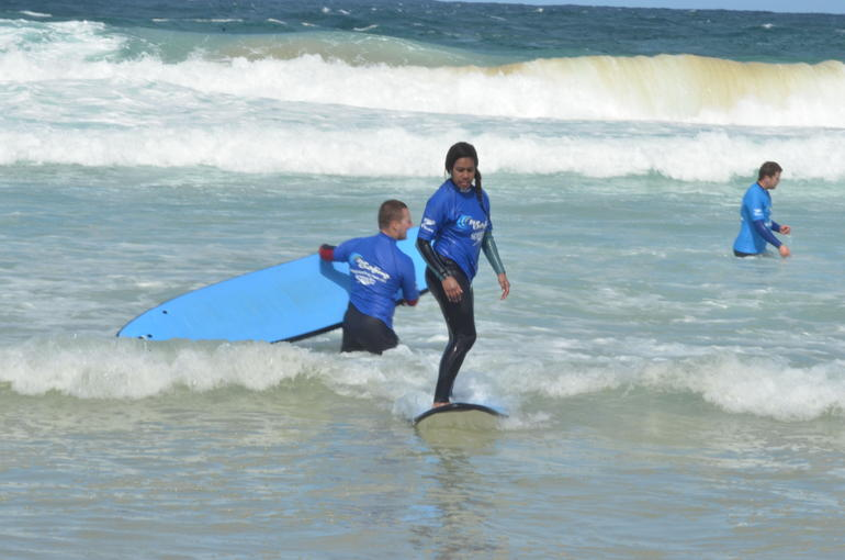 Surfing in tame waves, makes it easy and comfortable to learn how to actually stand up