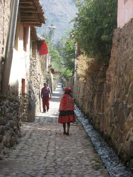 View down a street in Ollantaytambo. Local woman wearing traditional clothing., Bandit - December 2010