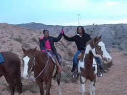 Photo of Las Vegas Wild West Sunset Horseback Ride with Dinner Riding through the valley