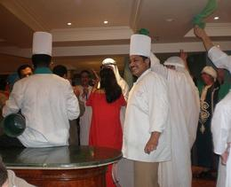Chefs joining the waiters to entertain at dinner - May 2008