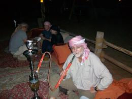 Photo of Dubai Luxury Desert Experience: Camel Safari with Dinner and Emirati Activities with Transport from Dubai a smoke at the end of the nite