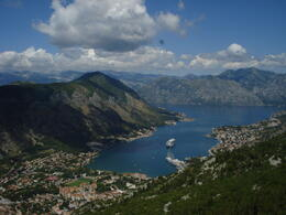 This was taken at 800m above sea level, on a mountain that has 32 hair pin bends, we were only at bend 25 here! . Its shows Kotor and the bay from above. , Emily M - August 2011