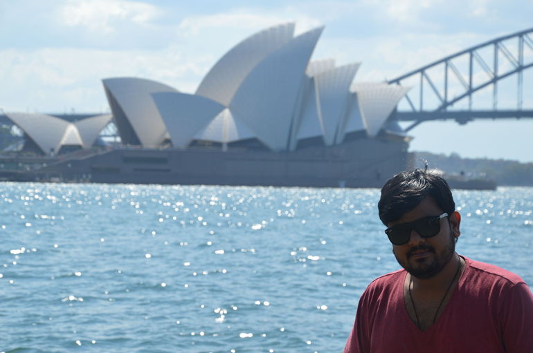 My husband with opera house and harbour Bridge. Beautiful location.