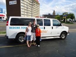 This is our amazing guide, Martha and our tour bus. , Mr Joshua C - August 2011