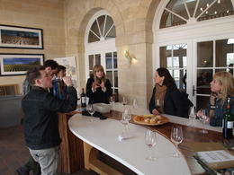 Photo of Bordeaux Small-Group Medoc or St-Emilion Wine Tasting and Chateaux Tour from Bordeaux Discussing wine in the Chateau Lagrange tasting room