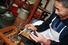 The owner of the restaurant is fixing one of his cooking utensils - June 2012