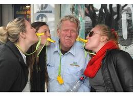 Photo of San Francisco San Francisco Duck Tour Kissing Captain Van with their quackers!