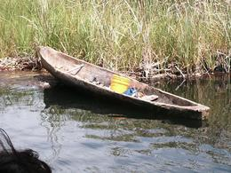 A local spear fisherman's boat, carved out of the trunk of a Cotton tree., Brenda N - April 2008