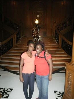 Photo of Orlando Titanic The Experience me and tav in front of the grand staircase