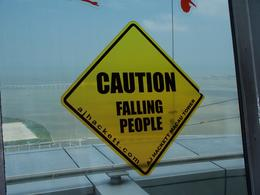A sign on the window at the top of Macau Tower... 274 meters above ground and the tallest bungee jump spot , Tien P - June 2012