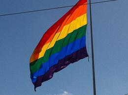 A picture of the pride flag that fliles over Harvey Milk square where the walk begins , Jeanelle C - March 2011