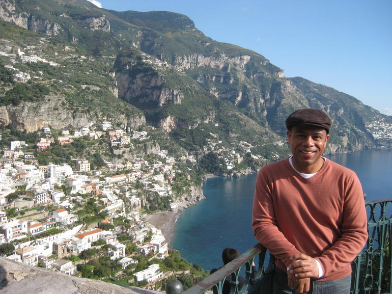 Photo of me at a stop before arriving in Positano. Beautiful town with nice quaint shops. The group lunch at the beach restaurant was great.