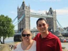 My husband and I on the Tower of London walls with the Tower Bridge in the background. , Monica B - July 2014