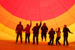 We are walking inside the balloon inflated by a huge fan before the flame of heat puts it upright. Totally Awesome! , SF - March 2013