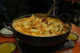 Ddeokbokki is a traditional Korean dish containing rice cake, fish cake, noodles and squid in a spicy sauce. - May 2013