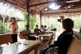 Photo of Ho Chi Minh City Mekong Delta Discovery Small Group Adventure Tour from Ho Chi Minh City Listening to Vietnamese music
