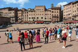 Our tour group learning about the Palio di Siena, the horse race that takes place twice a year in Siena's central square. Would be amazing to visit while the race is on. , Antony I - June 2014