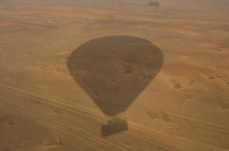 Hot air balloon shadow on the Dubai desert - Dubai