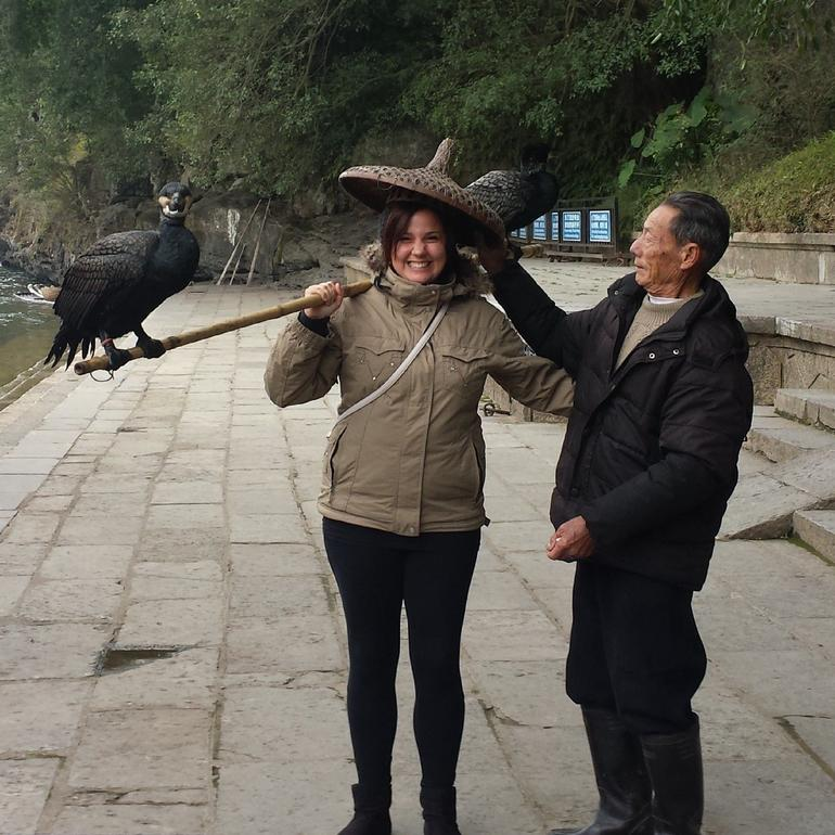 Me holding a Cormorant Fisher's pole - Guilin
