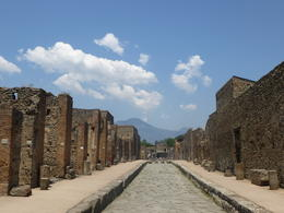 Looking down a street in the ancient town. Mount Vesuvius in the background. , Aaron S - June 2014