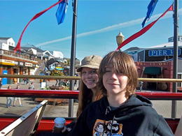 Alex and I in the bright sunlight on the top deck of the tour bus at Pier 39. , mary g - April 2013
