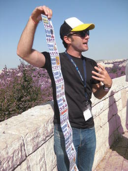 Our guide Itamar and his post card timeline at our first stop going into the city. Lots of p[eople wanted one of these but apparently they are only available to guides, which is a shame , Lynn L - October 2014