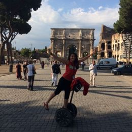 This is Martina our Tour Leader in front of the Colosseum striking a ballerina pose on her segway. , Elaine M - June 2015