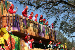 Photo of   A Mardi Gras float rolls through New Orleans throwing beads to the crowd