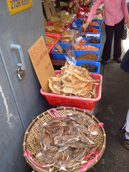 Photo of Hong Kong Lantau Island and Giant Buddha Day Trip from Hong Kong Dried fish/fish parts for sale at the fishing village