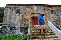 Our guide Jai tells us all about the Garrison house on Hassel Island , Adam B - March 2015