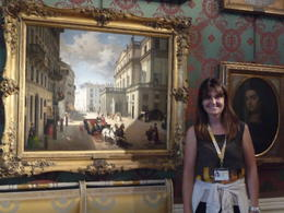 Our wonderful guide, Fedra, with a historic La Scala painting and another great story. , Cynthia F - July 2014