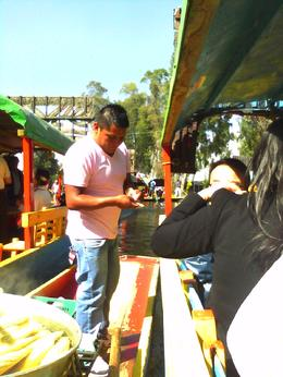 Photo of Mexico City Xochimilco and National University of Mexico Vendor selling roasted corn